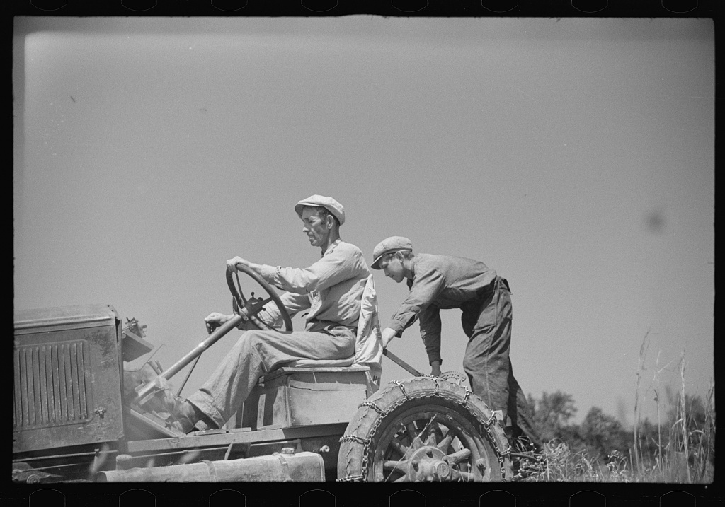 Luke Weldon, small farmer, and his son using ancient Buick (transformed by cutting down the chassis) as improvised tractor. Automobile bought in second hand car lot. Cost fifteen dollars. New Bridgeton, New Jersey