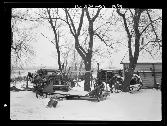 Machinery standing in open for lack of adequate shelter. Nelson Brothers farm, one hundred ninety-seven acres, near Dickens, Iowa