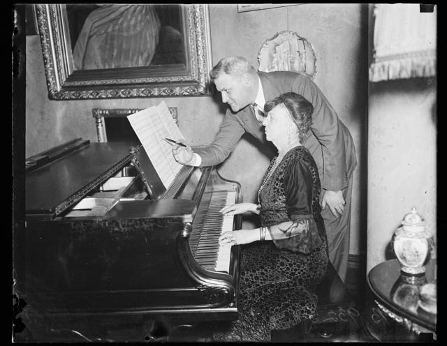 [Man and woman at piano]