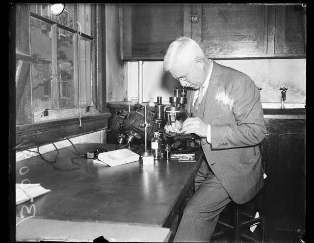 [Man using microscope in laboratory]