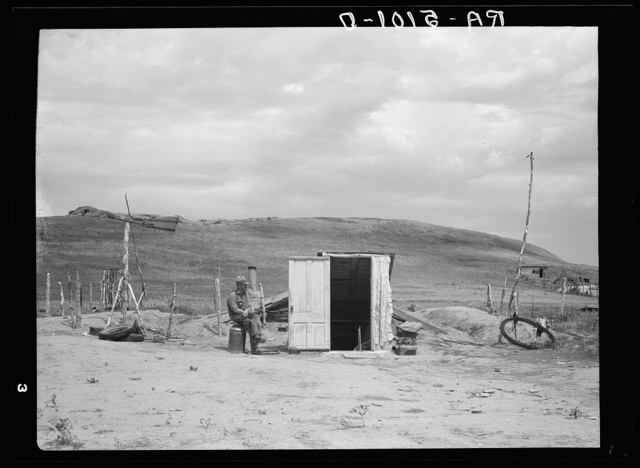Many farmers are abandoning their homes and moving into dugouts near towns to become eligible for drought relief. Grassy Butte, North Dakota