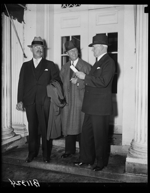 Maritime Commission at White House, Washington, D.C., Sept. 30. The members of the newly created Maritime Commission were called to the White House today for their first conference with President Roosevelt. Left to right: Rear Admiral Montgomery Taylor; George Landick, Jr., and Rear Admiral Henry A. Wiley
