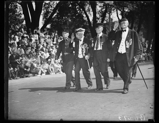 Memories of '65, Washington, D.C., Sept. 23. Pennsylvania Avenue again echoed with the footsteps of the Civil War Heroes as they trudged up the famous thoroughfare today in what may be the last parade for the Grand Army of the Republic. Slow but still firm of step the march brought back memories of '65 to these four vets. Left to right: G.H. Getz, Phila. Pa.; W.H. McKay, of Penna.; James Ryan, of Penna.; and Joe I. Rudolph, of Illinois