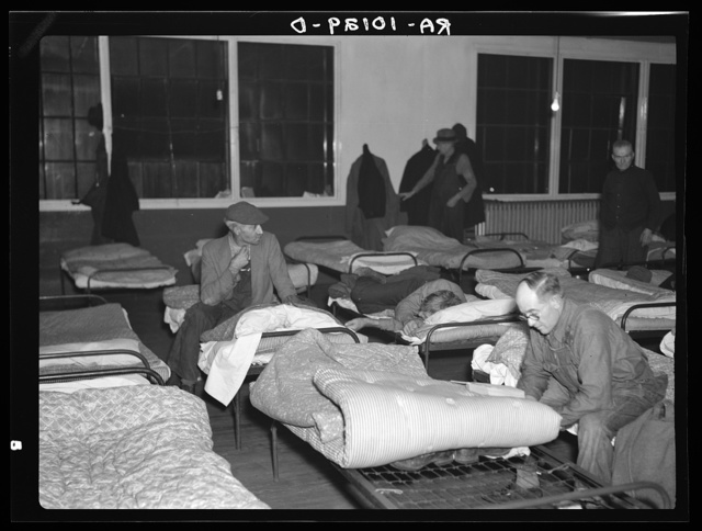 Men's dormitory at night at the homeless men's bureau, Sioux City, Iowa (for unattached men). Unemployment is the primary cause of their being here. This unemployment has been the direct cause of broken homes, through divorce and incompatibility. Most of the men are willing to work if they could find it. Average age fifty-two.  Most of the men are from the urban districts