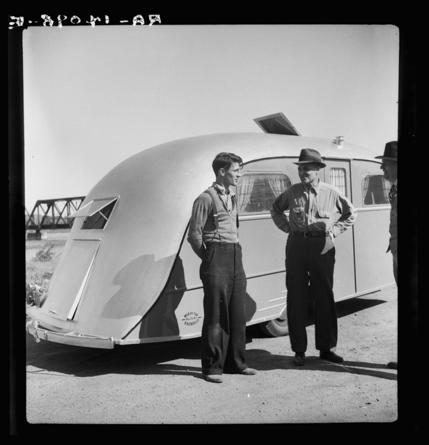 Messrs. Kaunetz [i.e., Kaunitz] (or Kauneel [name of company]), father and son, pioneers in auto trailers using yatch construction methods. Steam-bending elm. Bay City, Michigan