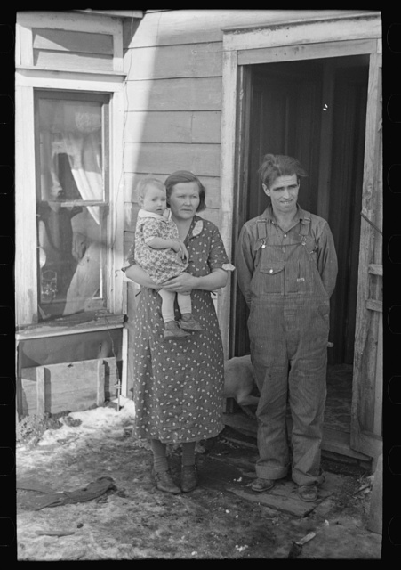 Mr. Rauhauser, wife and one of his seven children, Ruthven, Iowa. He works as a farm hand. At present he is out of work. He has made application for direct relief