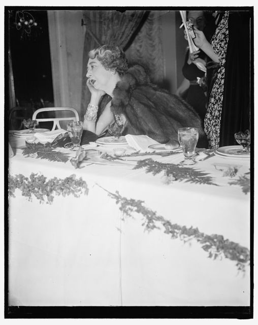 Mrs. E.B. McLean, with her Hope diamond and a armload of jewels seems to be deep in thought as to where her next load of diamonds are coming from
