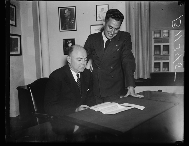 New and retiring heads of Veterans of Foreign Wars, Washington, D.C. Oct. 2. Bernard W. Kearney, (seated) recently elected National Commander of the Veterans of Foreign Wars at their annual convention in Denver, pictured at the national headquarters here with his predecessor James Van Zandt. Kearney who is now district attorney for Fulton County, N.Y., served with the 1st N.Y. cavalry during the World War. Van Zandt served as commander for three terms but refused the nomination this year