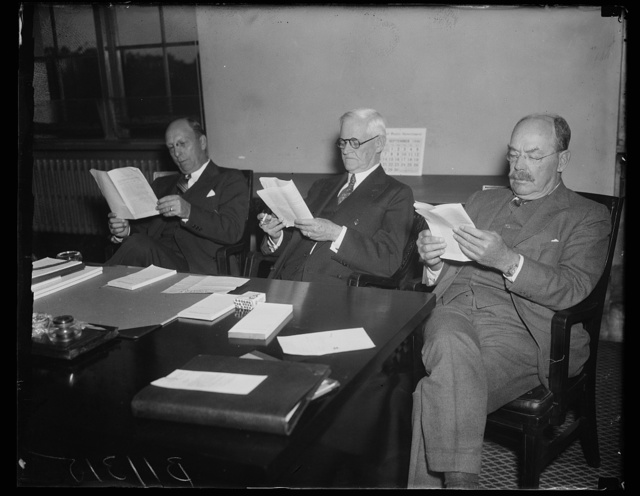 New Maritime Commission acts for first time, Washington, D.C. Sept. 29. The newly created Maritime Commission meeting for the first time today sent telegrams to West Coast shippers and union officials asking that working contract, which expire today, be extended for 60 days in an effort to prevent a maritime tieup. In the photograph, left to right: George Landick, Jr., Rear Admiral Henry A. Wiley, U.S.N., retired named temporarily to the commission in place of Admiral Harry G. Hamlet, who will not take office until after Oct. 1