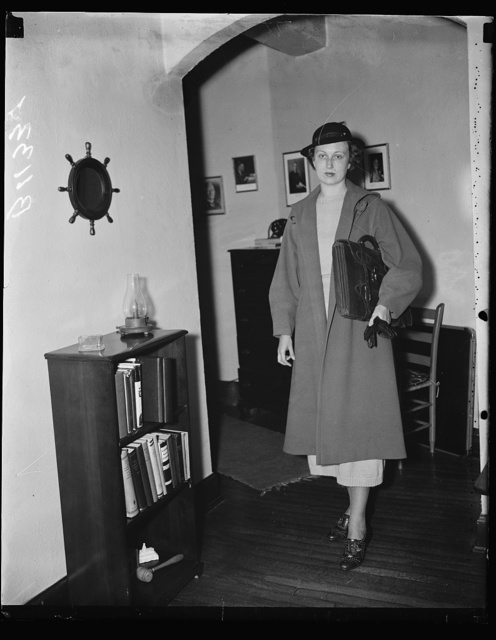 No. 3. Mrs. Moore leaves her apartment for day's duties. A long walk which keeps her in the best of physical condition is also on Mrs. Moore's daily program