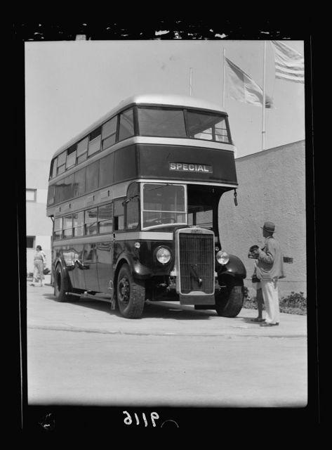 """Palestine disturbances 1936. An exhibit at the Fair """"a double decker"""" motor bus [Tel Aviv]"""