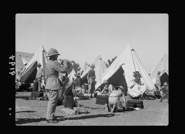 Palestine disturbances 1936. Bugler in camp of Scots Guard, sounding the call