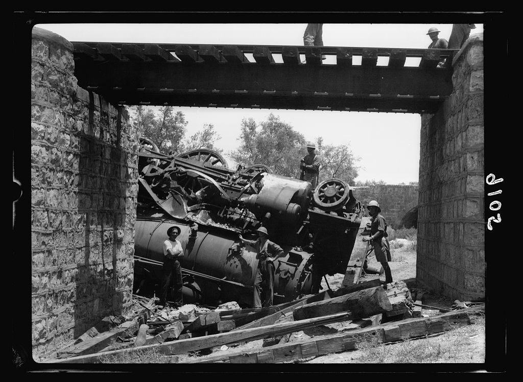 Palestine disturbances 1936. Capsized locomotive as seen through railroad bridge