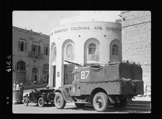 Palestine disturbances 1936. Friday military pay, being taken from Barclays Bank under escort of mounted machine-gun
