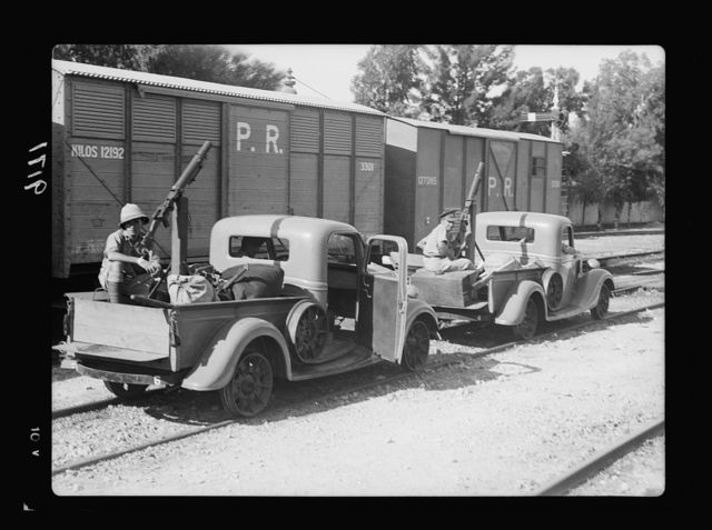 Palestine disturbances 1936. New trollies with machine-guns landed from the S.S. Dorsetshire and placed on the railroad track to patrole [i.e., patrol] the Palestine Railways