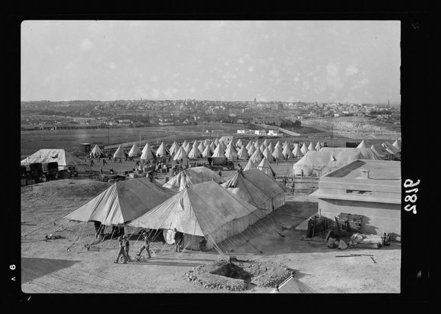 Palestine disturbances 1936. Pitching the Royal Signal's camp, canteen tents in the foreground [outside Jerusalem]