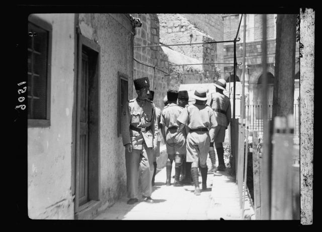Palestine disturbances 1936. Soldiers & police investigating a bomb explosion close to the District Commissioner's office
