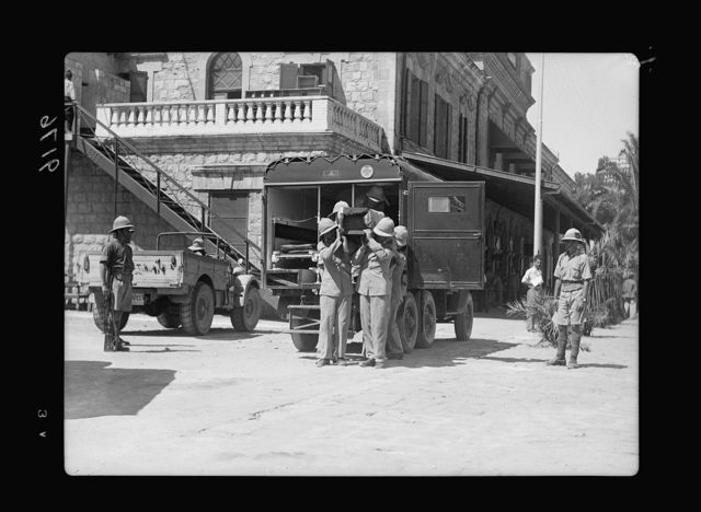 Palestine disturbances 1936. The body of Lt. Cpl. Merry who was shot near Safad, carried on shoulders from the ambulance in Haifa station