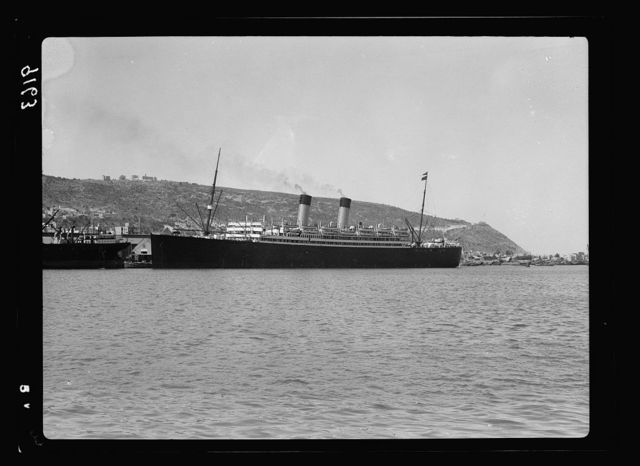 Palestine disturbances 1936. The luxury liner Laurentic docked in Haifa. Mt. Carmel is conspicuously seen in the background
