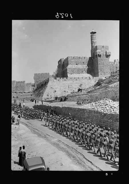 "Palestine disturbances 1936. The Scots Guards parade passing down Bethlehem road below the so-called ""Citadel"""