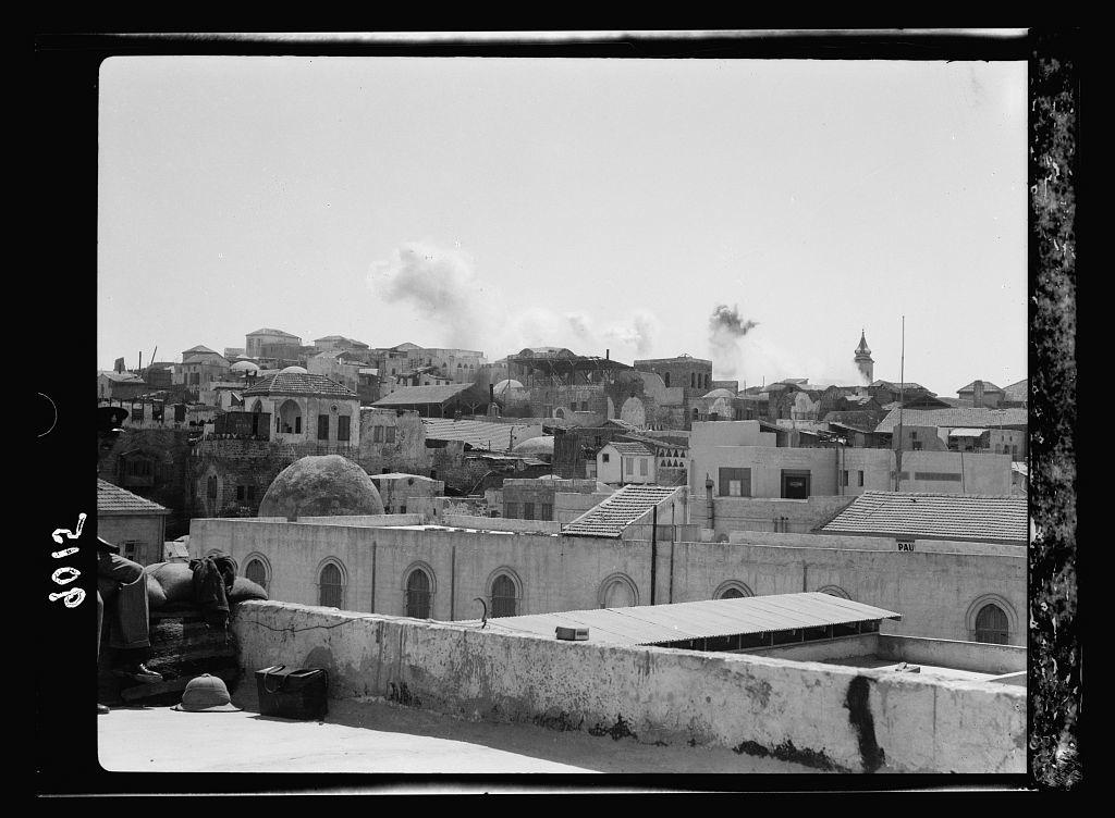 Palestine disturbances during summer 1936. Jaffa. Dynamiting slum section (distant view)