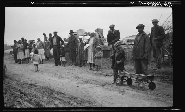 Parkin (vicinity), Arkansas. The families of evicted sharecroppers of the Dibble plantation. They were legally evicted the week of January 12, 1936, the plantation having charged that by membership in the Southern Tenant Farmers' Union they were engaging in a conspiracy to retain their homes; this contention granted by the court, the eviction, though at the point of a gun, was quite legal. The pictures were taken just after the evictions before they were moved into the tent colony they later enjoyed