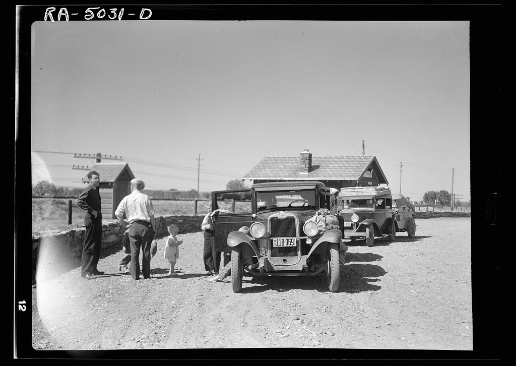 Part of the daily motorcade of drought refugees. The Montana-North Dakota state line