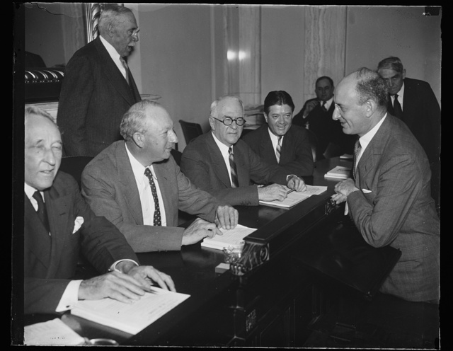 [Pat Harrison, 2nd from left; Robert M. La Follette, Jr., 2nd from right, Henry Morgenthau, right]