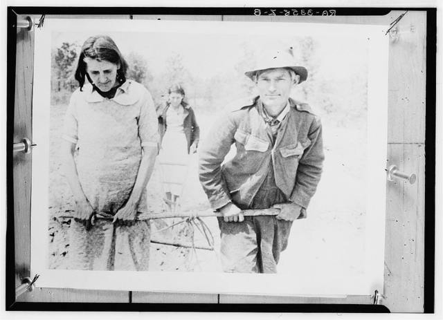 Paul J. Green and his wife and one of their daughters showing the way they worked their small plot in 1935 and the two preceding years before they received their horse from the Rural Settlement Administration, which they are using to work the land this year. A son makes up the fifth member of the family, which has been too proud to go on relief