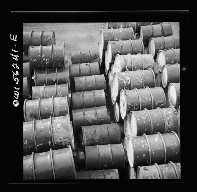 Philadelphia, Pennsylvania. File of oil drums near Grays Ferry Road