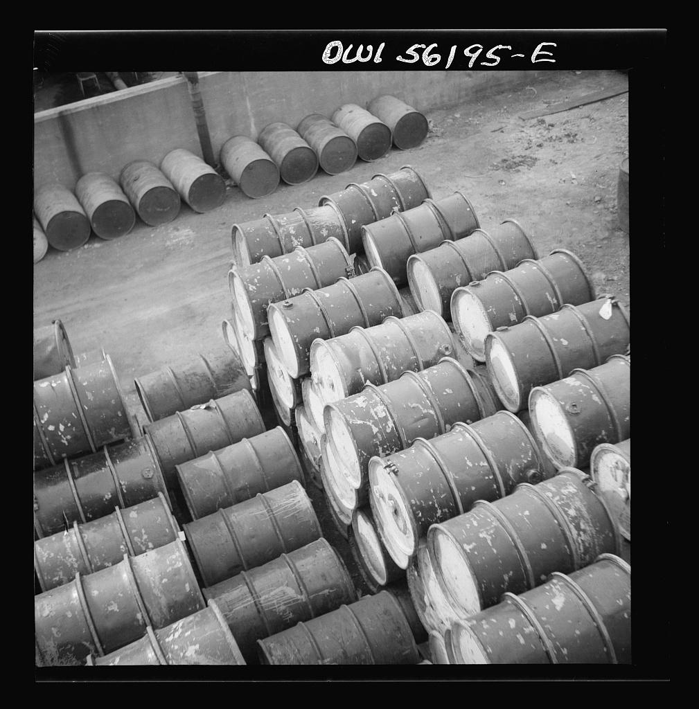Philadelphia, Pennsylvania. Pile of oil drums near Grays Ferry Road
