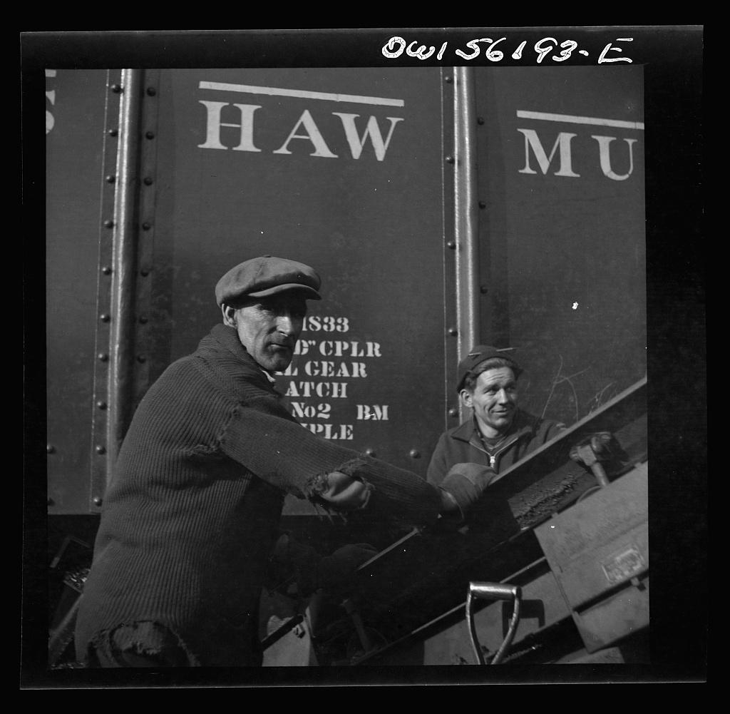 Philadelphia, Pennsylvania. Workmen in a coal yard near the South Street bridge