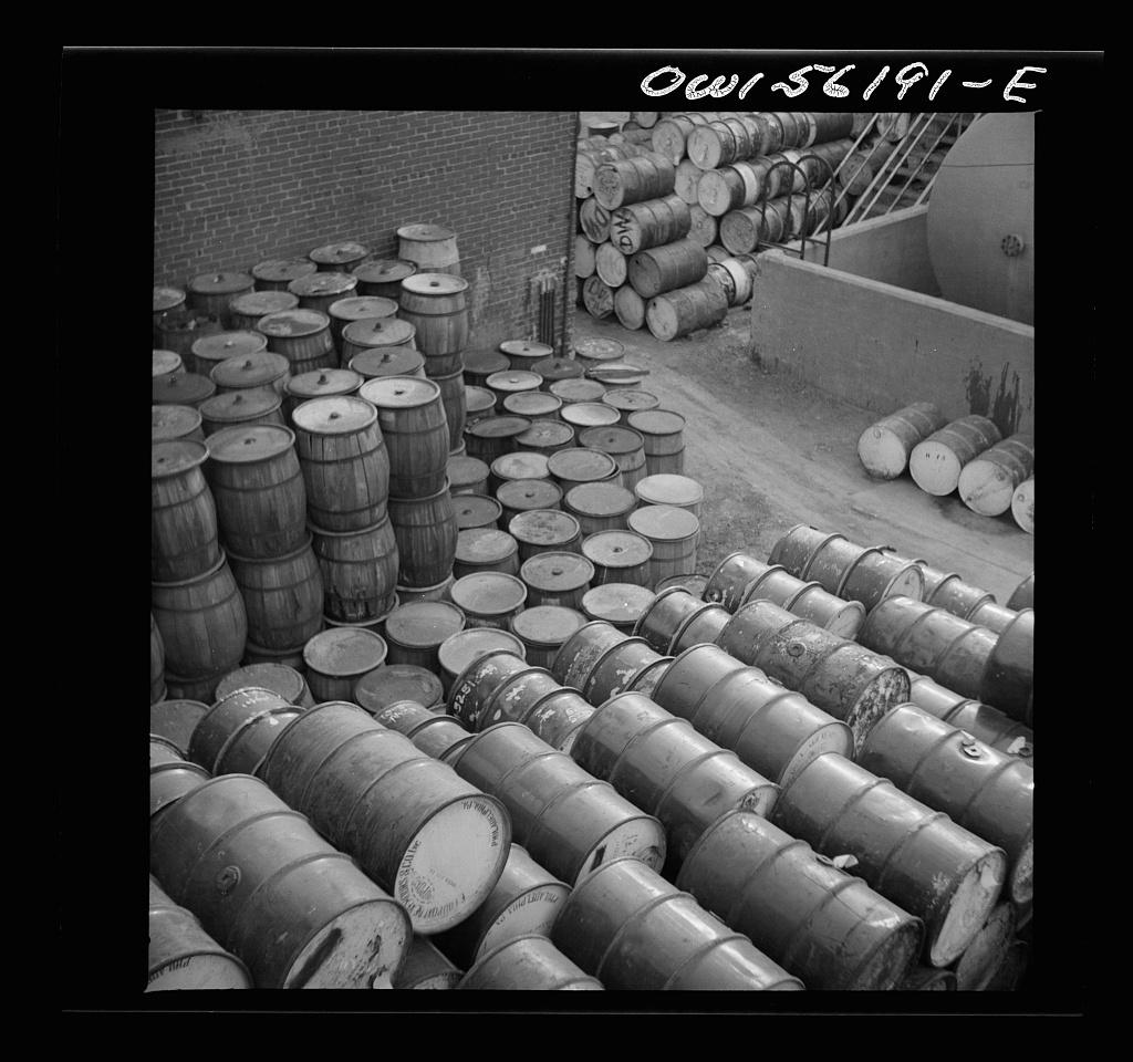 Philadephia, Pennsylvania. Pile of oil drums near Grays Ferry Road