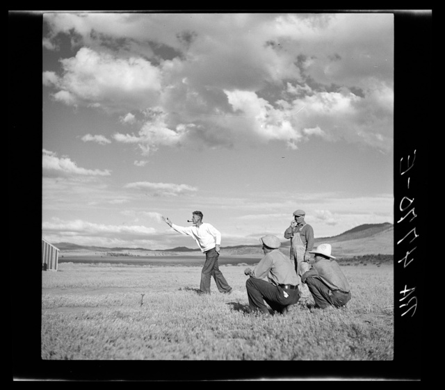 Pitching horseshoes at the Resettlement Administration camp. Madras, Oregon