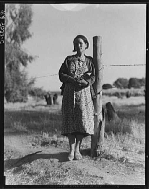 Pregnant migrant woman living in California squatter camp. Kern County