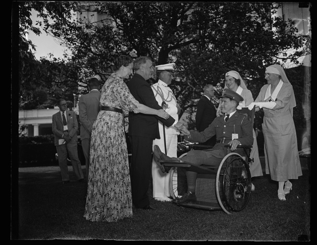 PRESIDENT AND MRS. ROOSEVELT ENTERTAIN DISABLED VETERANS AT GARDEN PARTY. WASHINGTON, D.C., MAY 21. DISABLED VETERANS CONFINED IN THE HOSPITALS IN AND AROUND WASHINGTON WERE ENTERTAINED BY PRESIDENT AND MRS. ROOSEVELT AT A GARDEN PARTY TODAY ON THE GROUNDS OF THE WHITE HOUSE. PRESIDENT ROOSEVELT IS SHOWN GREETING SOME OF THE VETERANS IN THIS PHOTOGRAPH