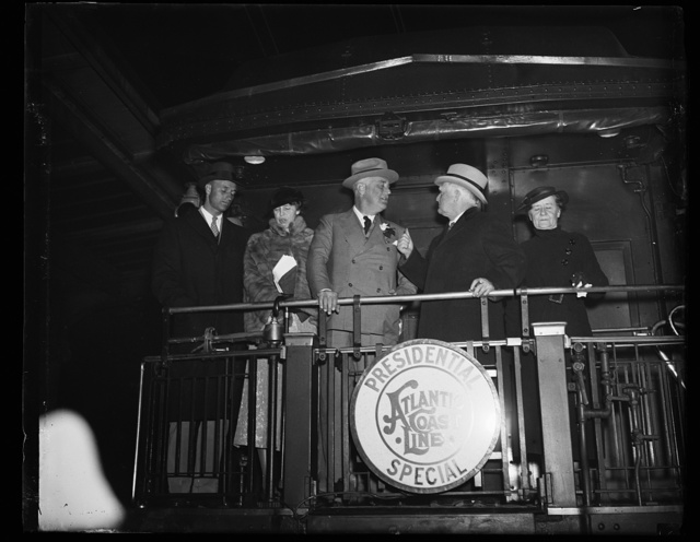 PRESIDENT RETURNS TO WASHINGTON. WASHINGTON, D.C. DECEMBER 5. PRESIDENT ROOSEVELT RETURNED FROM BUENOS AIRES TODAY. HE WAS MET AT THE STATION BY MRS. ROOSEVELT, VICE PRESIDENT AND MRS. GARNER, AND MEMBERS OF HIS CABINET. IN THE PHOTOGRAPH, L TO R: MRS. GARNER, VICE PRESIDENT GARNER, PRESIDENT ROOSEVELT, MRS. ROOSEVELT, AND JAMES ROOSEVELT