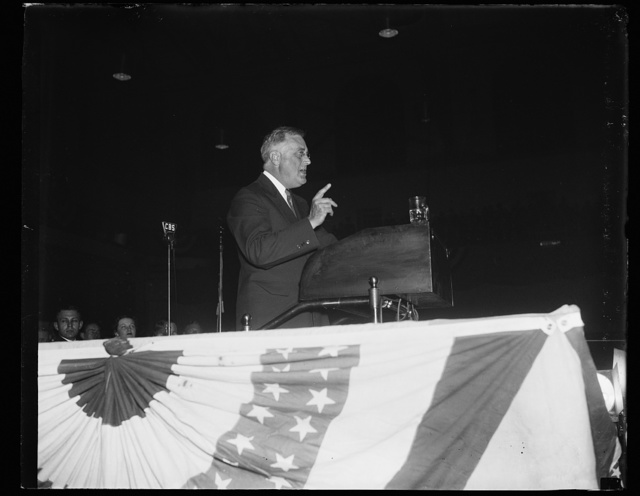 PRESIDENT SMILES. BALTIMORE, MD, APRIL 13. PRESIDENT ROOSEVELT ASSUMED A SERIOUS POSE AS HE PLUNGED DEEPER INTO HIS OPENING SPEECH OF THE 1936 CAMPAIGN. HIS SPEECH ON THE AVENUES TO THE YOUNG DEMOCRATS WAS DELIVERED IN BALTIMORE FOLLOWING A TORCH-LIGHT PARADE