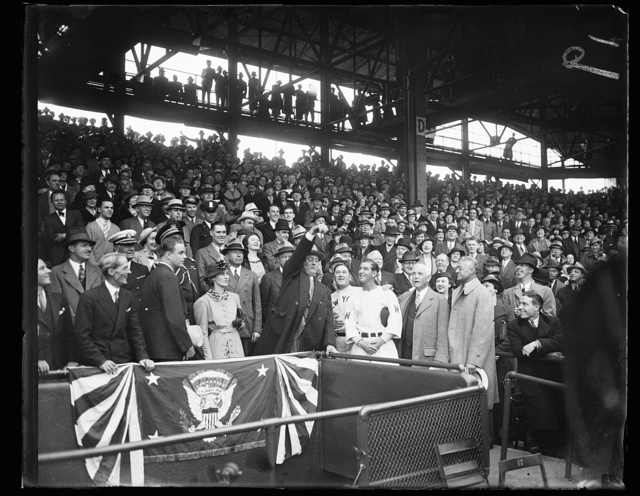 PRESIDENT TOSSES OUT FIRST BALL. WASHINGTON, D.C. APRIL 14. THE LID WAS OFFICIALLY PRIED OFF THE 1936 BASEBALL SEASON IN WASHINGTON TODAY WHEN PRESIDENT ROOSEVELT TOSSED OUT THE FIRST BALL TO START HOSTILITIES BETWEEN THE SENATORS AND THE NEW YORK YANKEES. IN THIS PHOTOGRAPH, L TO R: SECRETARY MARVIN McINTYRE; FRANKLIN D. ROOSEVELT, JR.; MRS. FRANKLIN D. ROOSEVELT, JR.; PRESIDENT ROOSEVELT; JOE McCARTHY, YANKEE MANAGER; BUCKEY HARRIS, SENATOR'S LEADER; CLARK GRIFFITH, PRESIDENT OF THE WASHINGTON BASEBALL CLUB; AND WILLIAM HARRIDGE, PRESIDENT OF THE AMERICAN LEAGUE