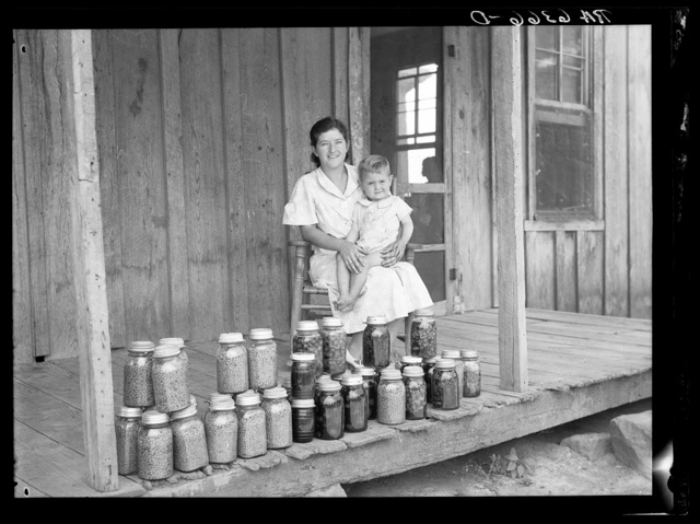 Rehabilitation client and food canned at the suggestion of Resettlement Administration rehabilitation supervisor. Near Batesville, Arkansas