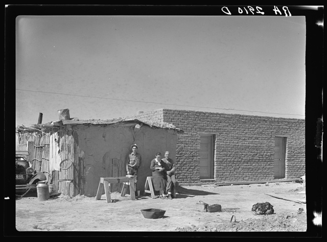 Rehabilitation clients. Mexican jacal on left in which they formerly lived and new houses built through Rettlement Administration loan. Dona Ana County, New Mexico