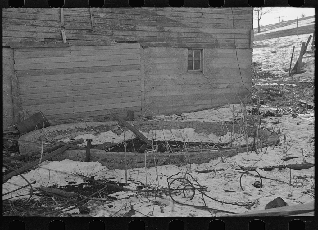 Remains of a silo on a 160 acre farm owned and operated by J.E. Herbrandson. The farm is now under heavy mortgage. An adequate windbreak on this farm would have prevented the silo from blowing down