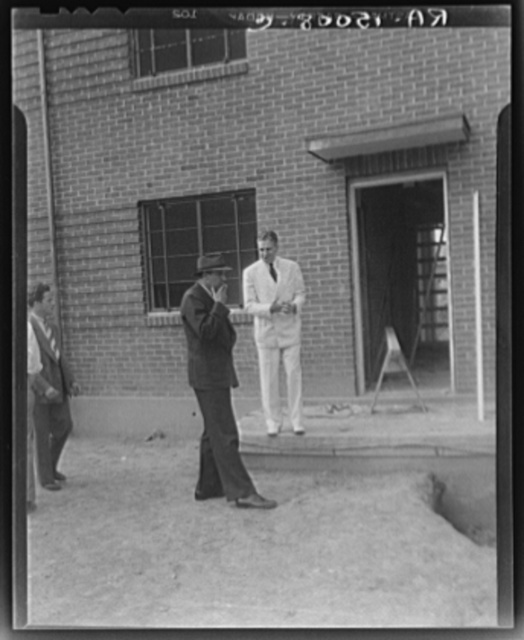 Resettlement Administrator, R.G. Tugwell and John L. Lansill inspecting houses under construction at Greenbelt, Maryland