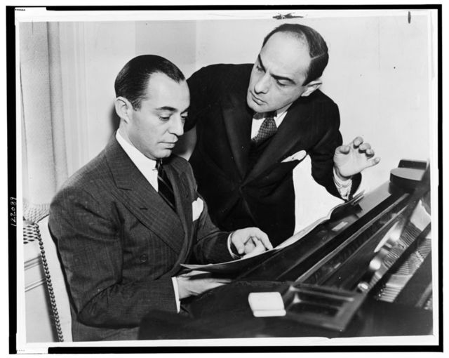 [Richard Rodgers seated at piano with Lorenz Hart on right] / World Telegram photo.