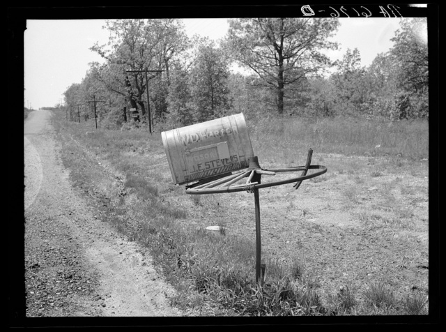 Rural mail box on old wagon wheel. Lake of the Ozarks, Missouri