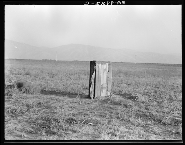 Sanitary facilities for migratory workers. Ditch bank camp. Squatters near Arvin, Kern County, California