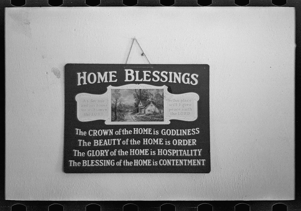 Sign in J.E. Herbrandson's farmhouse near Estherville, Iowa
