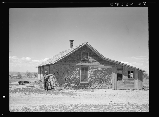 Sod house in which this man's father homesteaded thirty years ago. Pennington County, South Dakota