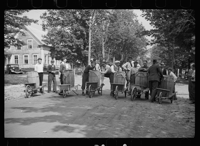 Start of the two-man wheelbarrow and barrel race. Fair at Albany, Vermont