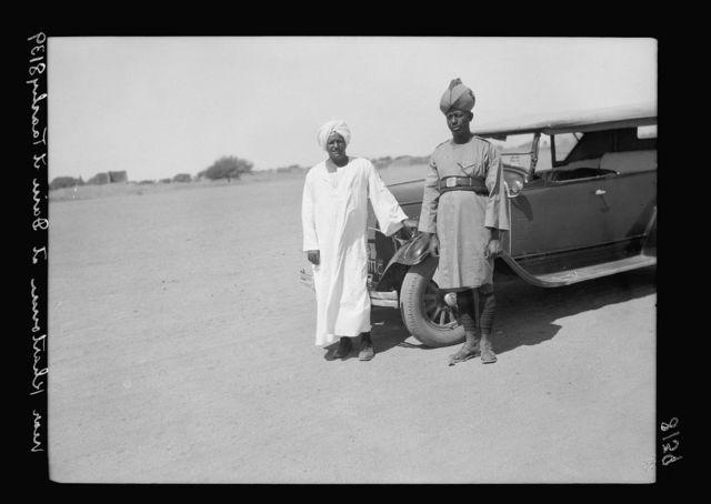 Sudan. Khartoum. Dain el-Tashy. Sudanese chauffeur & dragoman with car
